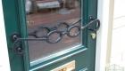 deurhandvat in vorm van een bril